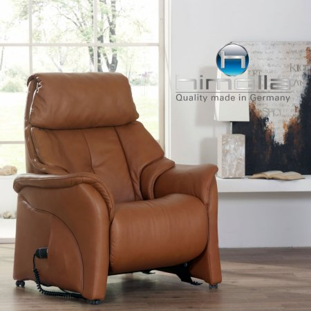 Armchairs And Footstools In Leather And Fabric